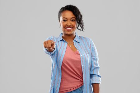 african american woman pointing finger at camera