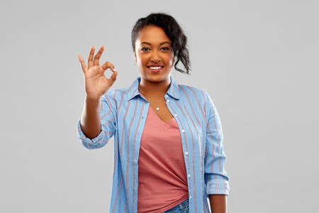 happy african american woman showing ok hand sign