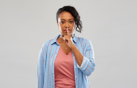 african american woman with finger on lips