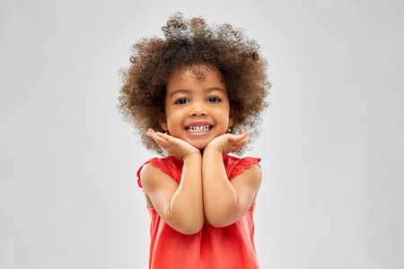 happy little african american girl over grey Archivio Fotografico