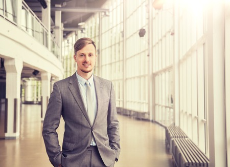 Young businessman in suit at office building hall