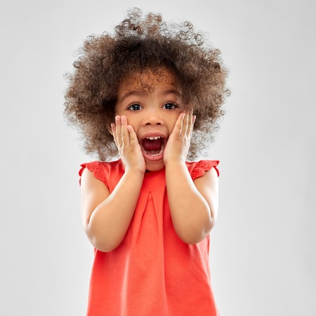 Surprised or scared little African American girl Stock Photo