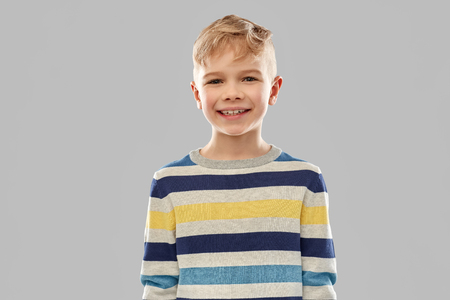 Portrait of smiling boy in striped pullover
