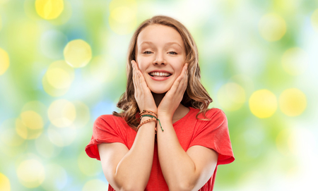 smiling teenage girl over green lights Stock Photo