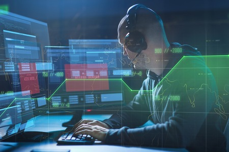 hacker with access denied messages on computers Stock Photo