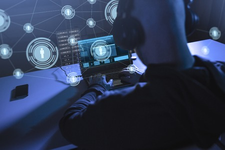 hacker with network using laptop computer