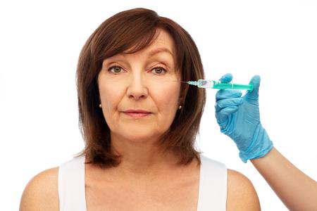 senior woman and surgeon hand with syringe Zdjęcie Seryjne