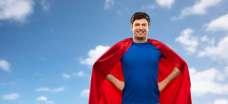 man in red superhero cape over sky background