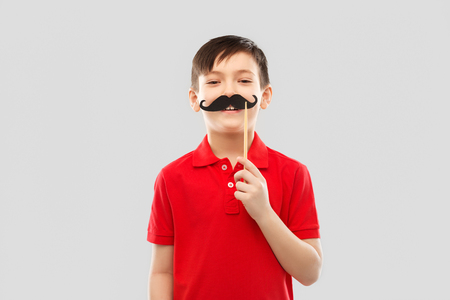 smiling boy in red t-shirt with black moustaches Stock Photo