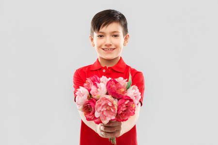 smiling boy with peony flowers