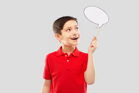 smiling boy in red t-shirt with speech bubble
