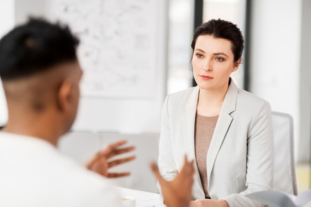 employer having interview with employee at office Stock Photo - 120859102