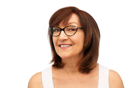Beauty, vision and old people concept - portrait of smiling senior woman in glasses over white background Imagens