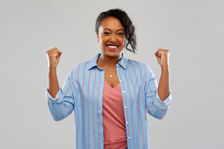 happy african american woman celebrating success