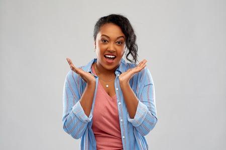 surprised african american woman shrugging