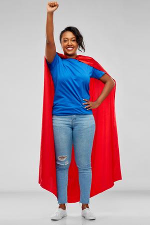 happy african american woman in superhero red cape 版權商用圖片