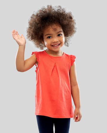happy little african american girl waving hand Banque d'images