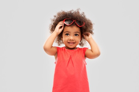 African American girl with heart shaped sunglasses Banco de Imagens