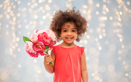 happy little african american girl with flowers