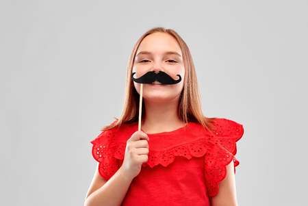 beautiful smiling girl with big black moustaches 版權商用圖片