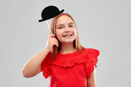 beautiful smiling girl with black bowler hat