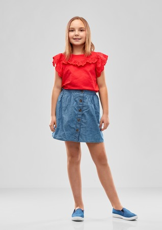 beautiful smiling girl in red shirt and skirt