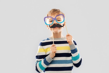 boy with glasses and black vintage moustaches Stock Photo