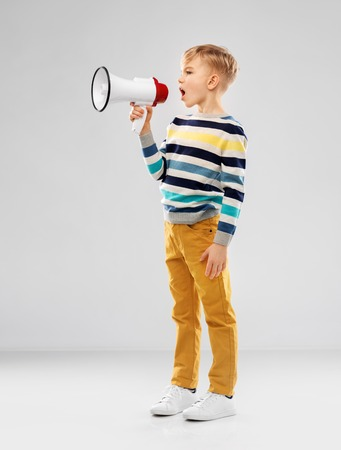 little boy speaking to megaphone