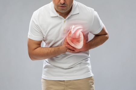 Close up of man having heart attack or heartache Stock Photo