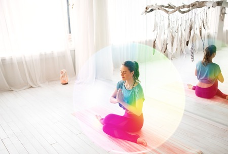 A woman meditating at yoga studio Standard-Bild