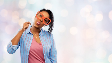 Happy African American woman with big glasses Stock Photo