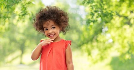Happy little African American girl in summer