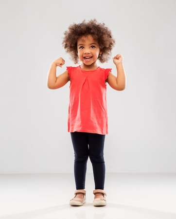 Happy little African American girl showing power 版權商用圖片