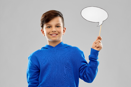 Smiling boy in blue hoodie with speech bubble