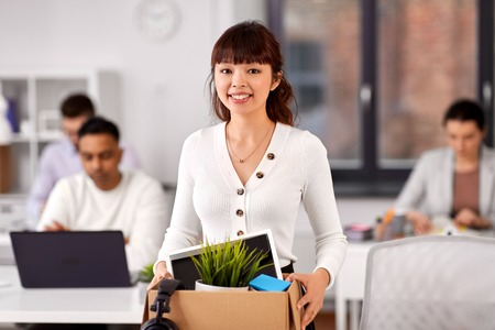 Female employee with personal stuff at office Imagens