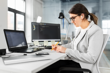 Businesswoman with notebook working at office