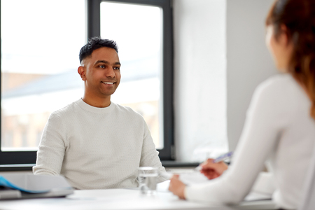 Employee having interview with employer at office
