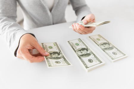 close up of woman hands counting us dollar money