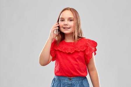 beautiful smiling girl calling on smartphone