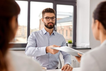 male employee having job interview with recruiters Stock Photo - 121617800