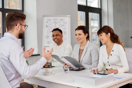 recruiters having job interview with male employee Stock Photo