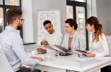 recruiters having job interview with male employee Stock Photo - 121617805