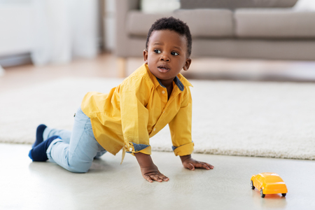 african american baby boy playing with toy car Stok Fotoğraf