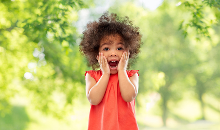 surprised little african american girl in summer Stock Photo