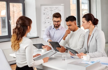 team of recruiters with tablet pc at job interview