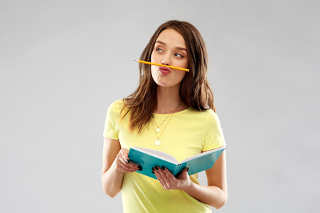 teenage student girl with notebook and pencil