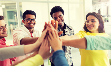 Group of international students making high five Stockfoto