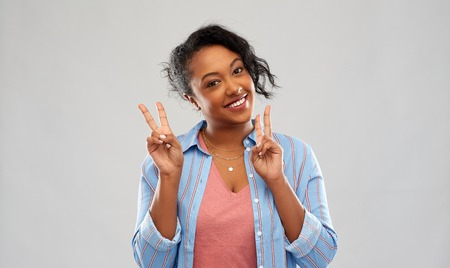Happy African american woman showing peace Stock Photo