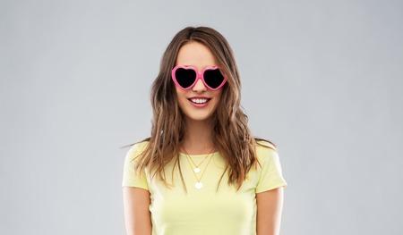 Teenage girl in heart-shaped sunglasses