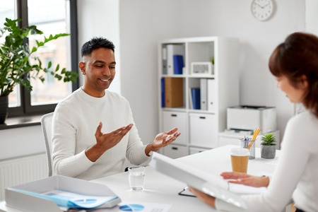 Employee having interview with employer at office Stock Photo - 121996694